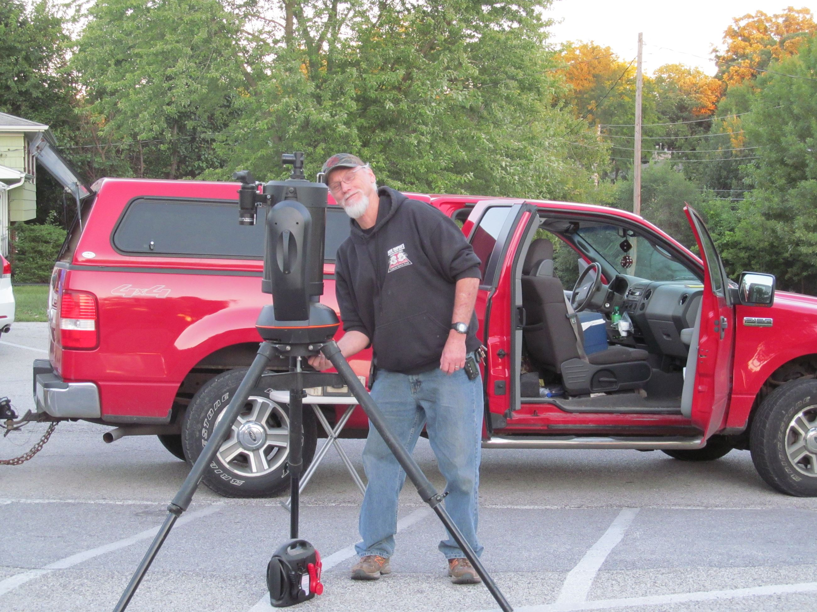 A Popular Astronomy Club member lines up his electronic telescope for star viewing