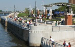 Visitors standing at edge near water of Schwiebert Riverfront Park