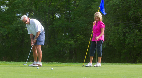 Couple golfing at Saukie Golf Course